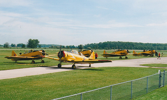 CHAA Harvard Bessy CF UFZ taxis out with other Harvards on the flight line July 20 2019