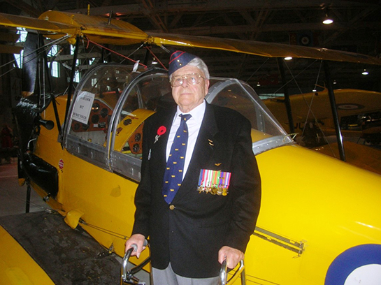 Norm Reid with Tiger Moth