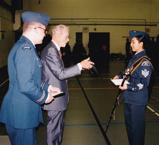 Sheldon Benner presents FSgt Zoe Elizabeth Eng Tsieng Chee of 631 Sentinel Squadron with a descriptive plaque outlining the 2017 J. Milton Patterson Award