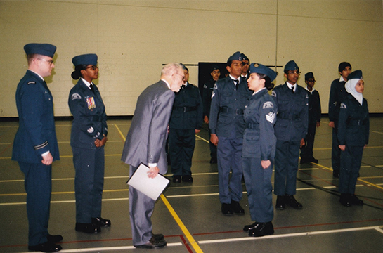 The multicultural diversity of 631 Sentinental Squadron is evident as Sheldon Benner participates in the inspection