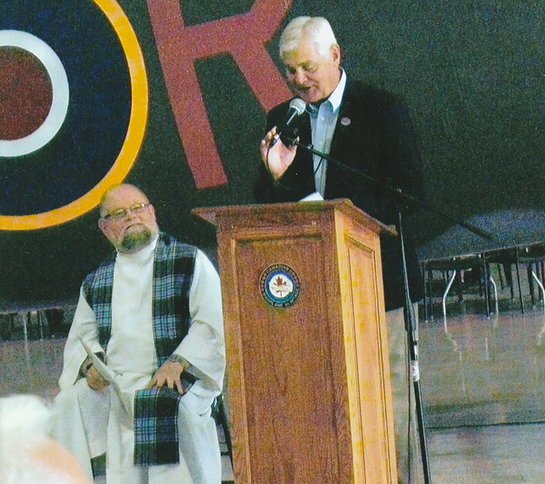 14 David Rohrer CEO and Chairman of CWHM speaks at the Official Dedication as Padre Rev Doug Mitchell looks on Osborne R Love