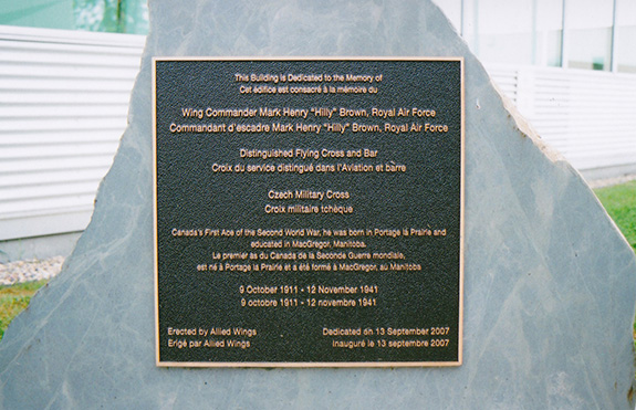 Plaque outlining dedication of the Wing Commander Mark Henry Hilly Brown building at Southport Aerospace Centre