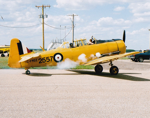 Puffs of white smoke erupted from the engine as pilot Jeff Bell fired up the CATP Museum Harvard Mk 2 C FMGZ