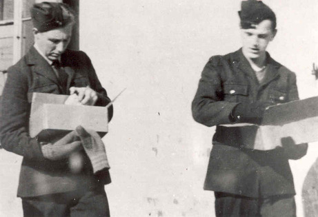 17 Fellow POWs looking at Red Cross packages feature