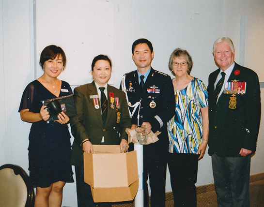 Enjoying reception from left SoYoung Lee HooJung Col Chang Bae Yoon Angie McNulty Don Kennedy