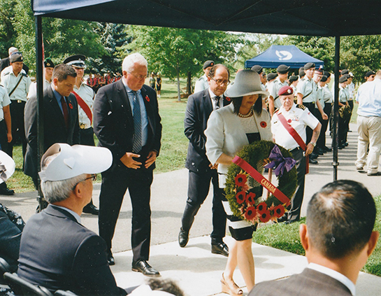 Senator Yonah Martin presents a wreath on behalf of Canada during the memorial service at Meadowvale Cemetery on July 27