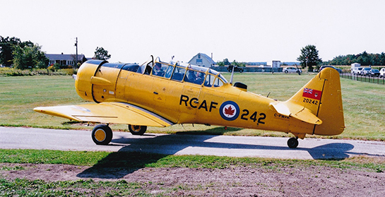 CHAA pilot Allan Paige in Harvard Mk 4 C FWPK takes a passenger for a flight at Brampton Caledon Airport Day Gord McNulty